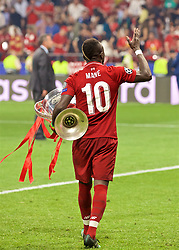 MADRID, SPAIN - SATURDAY, JUNE 1, 2019: Liverpool's Sadio Mane with the trophy after the UEFA Champions League Final match between Tottenham Hotspur FC and Liverpool FC at the Estadio Metropolitano. Liverpool won 2-0 to win their sixth European Cup. (Pic by David Rawcliffe/Propaganda)