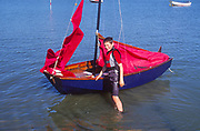 AT5BYB Young boy with his Mirror dinghy sailing boat