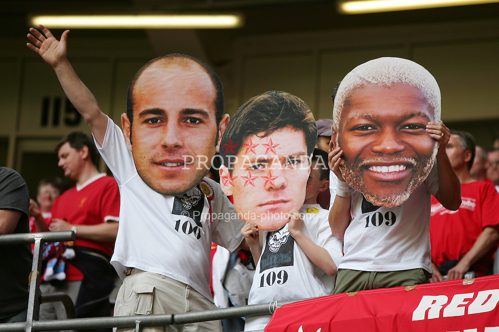 CARDIFF, WALES - SATURDAY, MAY 13th, 2006: Liverpool's fans wearing giant cup-out faces of Jose Reina, Xabi Alonso and Djibril Cisse before the FA Cup Final against West Ham United at the Millennium Stadium. (Pic by David Rawcliffe/Propaganda)