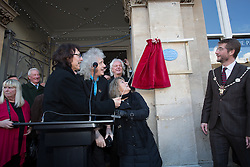 © London News Pictures. 07/01/2016 Cirencester, UK.  A plaque is unveiled in memory legendary rock drummer Cozy Powell by (L-R)  Black Sabbath guitarist Tony Iommi, Queen guitarist Brian May and Suzi Quattro as Cirencester Mayor Mark Harris (R) looks on. Powell was born in Cirencester before going on to play in  major rock bands  - The Jeff Beck Group, Rainbow, Robert Plant, Whitesnake and Black Sabbath. Photo credit: Stephen Shepherd/LNP