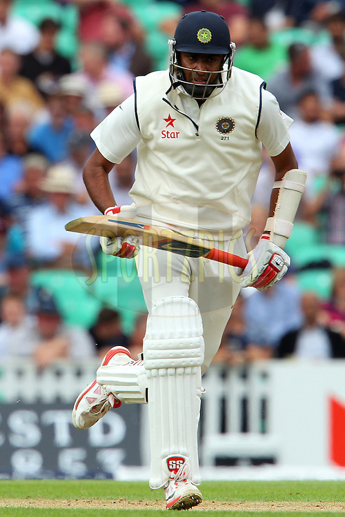 Ravichandran Ashwin of India sets off during day one of the fifth Investec Test Match between England and India held at The Kia Oval cricket ground in London, England on the 15th August 2014<br /> <br /> Photo by Ron Gaunt / SPORTZPICS/ BCCI