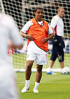 Photo: Chris Ratcliffe.<br />England training session. 06/06/2006.<br />Theo Walcott tickles his ribs in England's first training session.