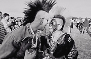Two punks with mohicans laughing Ashton Court festival Bristol 1990's