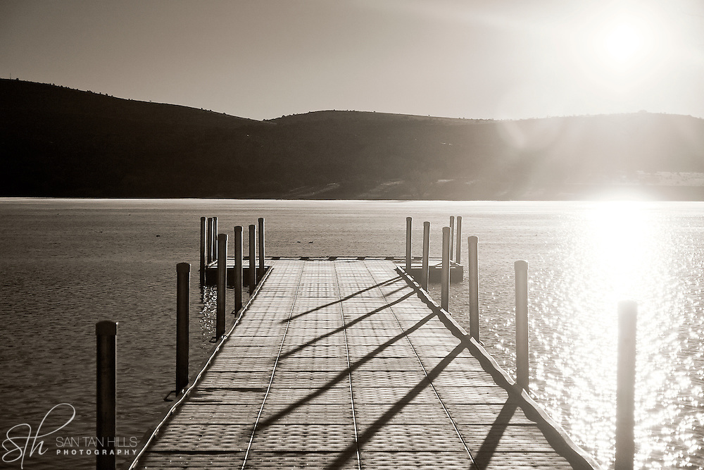 A dock extending out on Watson Lake at sunrise - Prescott, AZ