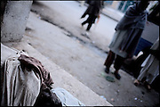 """A dead body of a drug addict found by some friends. Hard abuse of heroin, disease and lack of food these are the only know existance of many poor people. Rawalpindi, Pakistan, on thursday, November 27 2008.....""""Pakistan is one of the countries hardest hits by the narcotics abuse into the world, during the last years it is facing a dramatic crisis as it regards the heroin consumption. The Unodc (United Nations Office on Drugs and Crime) has reported a conspicuous decline in heroin production in Southeast Asia, while damage to a big expansion in Southwest Asia. Pakistan falls under the Golden Crescent, which is one of the two major illicit opium producing centres in Asia, situated in the mountain area at the borderline between Iran, Afghanistan and Pakistan itself. .During the last 20 years drug trafficking is flourishing in the Country. It is the key transit point for Afghan drugs, including heroin, opium, morphine, and hashish, bound for Western countries, the Arab states of the Persian Gulf and Africa..Hashish and heroin seem to be the preferred drugs prevalence among males in the age bracket of 15-45 years, women comprise only 3%. More then 5% of whole country's population (constituted by around 170 milion individuals),  are regular heroin users, this abuse is conspicuous as more of an urban phenomenon. The substance is usually smoked or the smoke is inhaled, while small number of injection cases have begun to emerge in some few areas..Statistics say, drug addicts have six years of education. Heroin has been identified as the drug predominantly responsible for creating unrest in the society."""""""