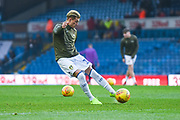 Ezgjan Alioski of Leeds United (10) takes a shot during the warm up during the EFL Sky Bet Championship match between Leeds United and Bristol City at Elland Road, Leeds, England on 24 November 2018.
