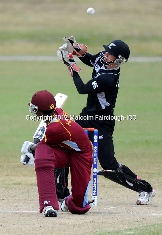 TOWNSVILLE, AUSTRALIA - AUGUST 20:  Akeal Hosein of the West Indies edges the ball past Cameron Fletcher of New Zealand during the ICC U19 Cricket World Cup 2012 Quarter Final match between New Zealand and the West Indies at Endeavour Park on August 20, 2012 in Townsville, Australia.  (Photo by Malcolm Fairclough-ICC/Getty Images)