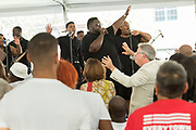 Singer Jarell Smalls, center, leads the audience in praise songs during a memorial service for the victims of the Mother Emanuel African Methodist Episcopal Church shooting on the 2nd anniversary June 17, 2017 in Charleston, South Carolina. Nine members of the historic African-American church were gunned down by a white supremacist during bible study on June 17, 2015.