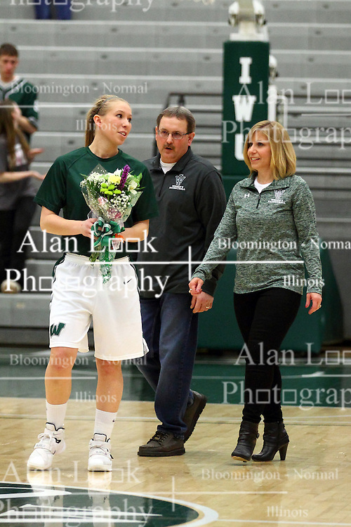 20 February 2016:  Samantha Ellsworth gets the only honor on Senior Night with her parents during an NCAA women's basketball game between the Elmhurst Bluejays and the Illinois Wesleyan Titans in Shirk Center, Bloomington IL