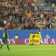 GRENOBLE, FRANCE June 18.  Sam Kerr #20 of Australia looks on was Jamaica celebrate after scoring a goal during the Jamaica V Australia, Group C match at the FIFA Women's World Cup at Stade des Alpes on June 18th 2019 in Grenoble, France. (Photo by Tim Clayton/Corbis via Getty Images)