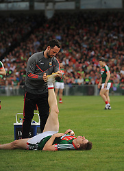 Mayo&rsquo;s Lee Keegan assisted by Barry Solan gets some stretches in at the Gaelic grounds.<br /> Pic Conor McKeown