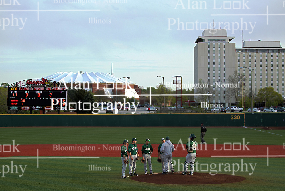 21 April 2015:  Redbird arena is seen behind the scoreboard of Duffy Bass Field during an NCAA Inter-Division Baseball game between the Illinois Wesleyan Titans and the Illinois State Redbirds in Duffy Bass Field, Normal IL<br /> <br /> This image is a High Dynamic Range Composition (HDR) processed image combining 3 different images.