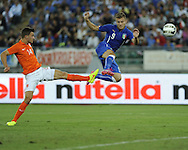 Ciro Immobile of Italy (right) shoots for goal under pressure from Joel Veltman of Netherlands during the International Friendly match at Stadio San Nicola, Bari<br /> Picture by Stefano Gnech/Focus Images Ltd +39 333 1641678<br /> 04/09/2014