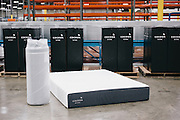 BELMONT, MS – MARCH 3, 2016: A compressed and rolled Cocoon mattress stands next to the product as seen when unboxed. Cocoon mattresses are compressed and vacuum sealed during production in order to allow for direct shipment to ecommerce customers.<br /> <br /> As the ecommerce revolution extends to larger household items, mattress giant Tempur Sealy has developed a mattress in a box solution to appeal to online shoppers. CREDIT: Bob Miller for The Wall Street Journal<br /> MATTRESS