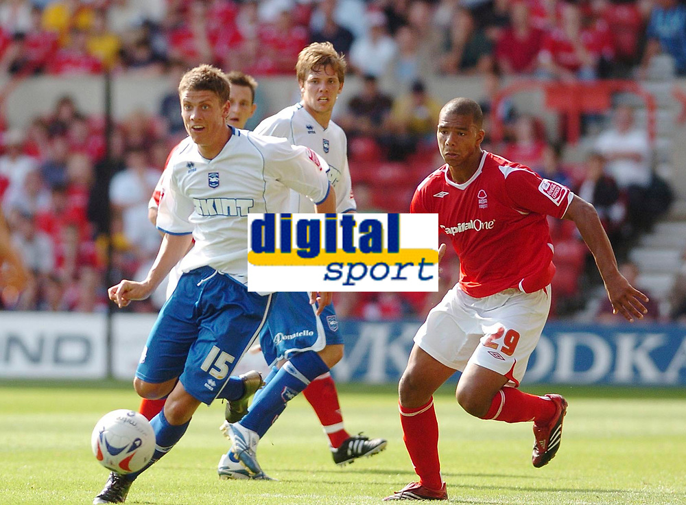 Photo: Leigh Quinnell.<br /> Nottingham Forest v Brighton & Hove Albion. Coca Cola League 1. 19/08/2006. Brightons Alex Revell breaks away from Forests Julian Bennett.