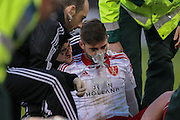 Sheffield United defender Robert Harris goes off injured  during the The FA Cup match between Sheffield Utd and Oldham Athletic at Bramall Lane, Sheffield, England on 5 December 2015. Photo by Simon Davies.