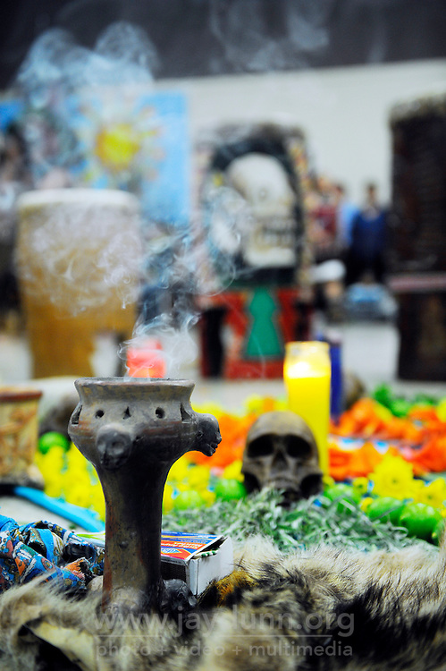 Incense rises from an altar on the floor of the community room at El Dorado Park in Salinas. Yaocuauhtli - Eagle Warrior's weekly dances on Thursday evenings are open to all. The gatherings are both instructional and devotional, and can last many hours.
