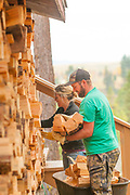 Stacking wood, family work day, chopping wood for winter, McCall, Idaho. MR