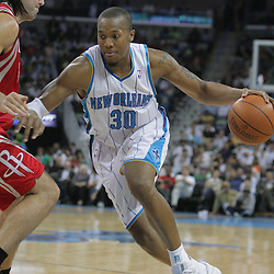 16 March 2009: New Orleans Hornets forward David West (30) drives past Houston Rockets forward Luis Scola (4) during a NBA game between the New Orleans Hornets and the Houston Rockets at the New Orleans Arena in New Orleans, Louisiana.