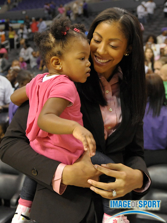 Aug 9, 2010; Los Angeles, CA, USA; Los Angeles Sparks forward Candace Parker holds her daughter Lailaa Williams after the game against the Indiana Fever at the Staples Center. Photo by Image of Sport