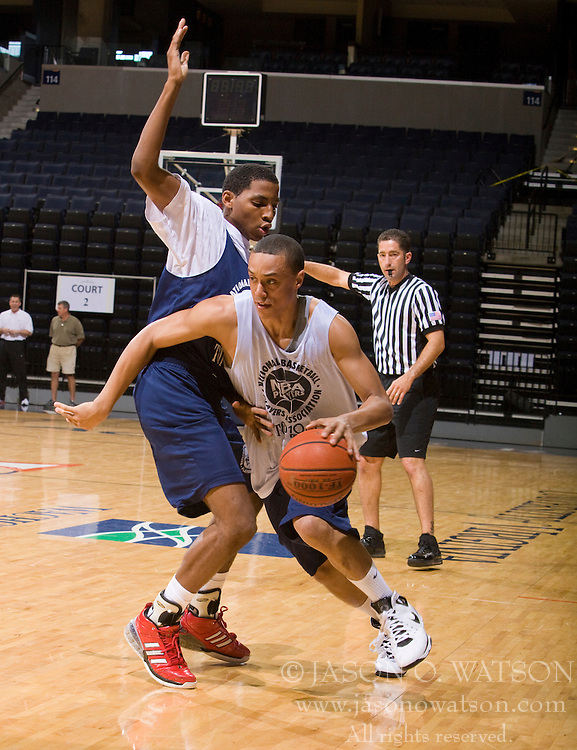G/F John Jenkins (Gallatin, TN / Station Camp) dribbles past G/F Nicos Norris (Mendenhall, MS / Genesis One).  The NBA Player's Association held their annual Top 100 basketball camp at the John Paul Jones Arena on the Grounds of the University of Virginia in Charlottesville, VA on June 19, 2008