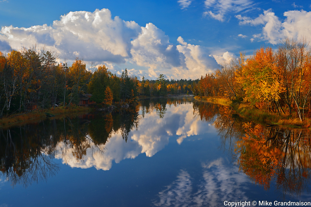 Autumn colors reflected in the Wanapitae River<br /> Killarney District<br /> Ontario<br /> Canada