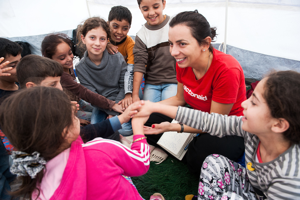 Hara Tasoglou, head of communications of ActionAid Hellas talking to kids from Iraq in Kara Tepe camp, Lesvos, Greece
