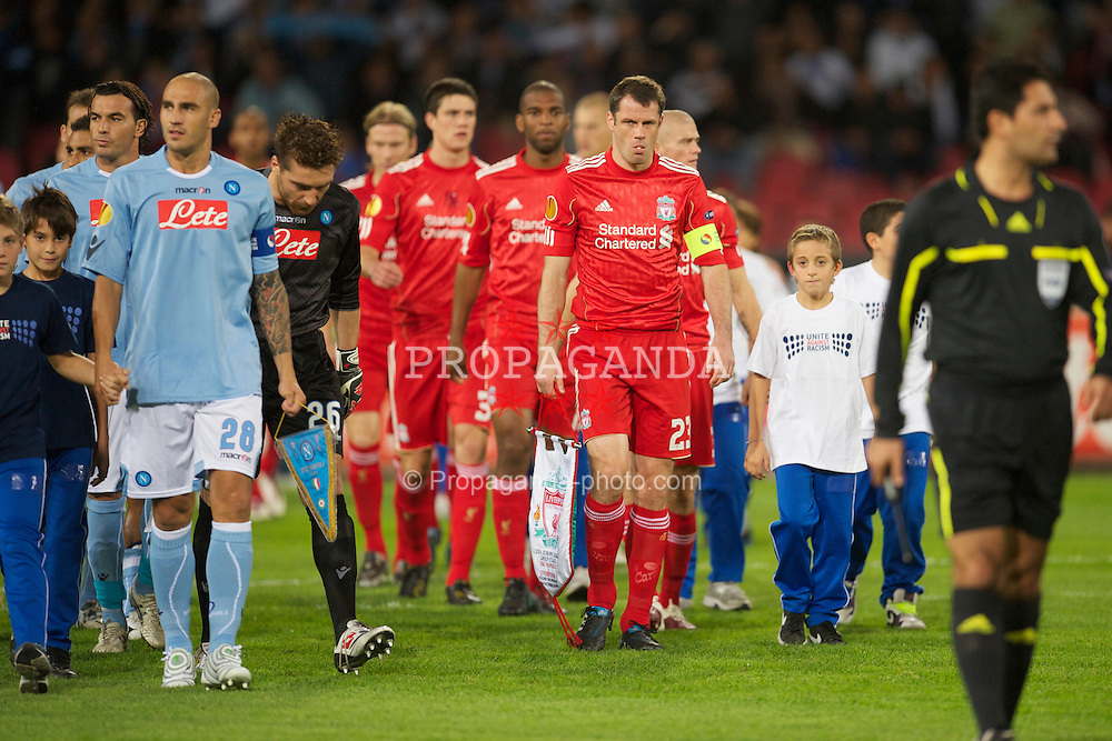 NAPELS, ITALY - Thursday, October 21, 2010: Liverpool's captain Jamie Carragher leads his side out to face SSC Napoli during the UEFA Europa League Group K match at the Stadio San Paolo. (Pic by: David Rawcliffe/Propaganda)
