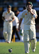 "Brad Haddin calls for new gloves after a hot afternoon in the middle late on Day 1 of the 1st Test in the 2013-14 Ashes Cricket Series between Australia and England at the GABBA (Brisbane, Australia) from Thursday 21st November 2013<br /> <br /> Conditions of Use : NO AGENTS ~ This image is subject to copyright and use conditions stipulated by Cricket Australia.  This image is intended for Editorial use only (news or commentary, print or electronic) - Required Image Credit : ""Steven Hight - AURA Images"""