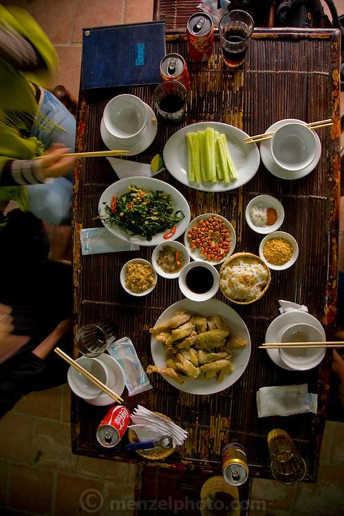 Lunch in a roadside restaurant near So village, south-west of Hanoi, Vietnam.