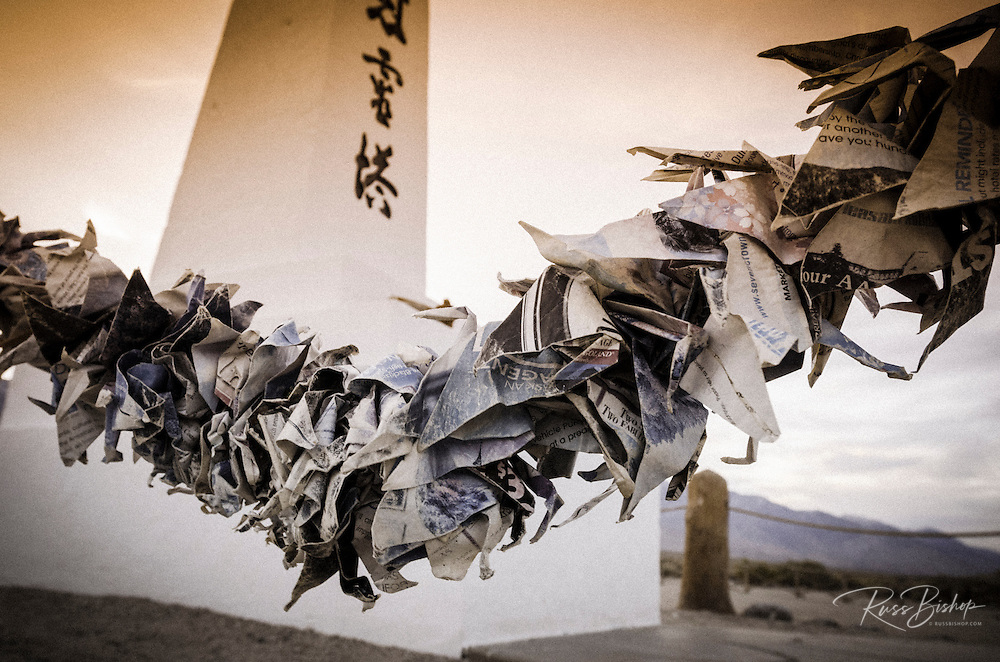 Origami and oblisk in the Manzanar Cemetery, Manzanar National Historic Site, Lone Pine, California USA