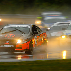 The Compass360 Racing Honda Civic SI driven by Gareth Nixon and David Thilenius during the Grand-Am Continental Tire Sports Car Challenge ST race at Lime Rock Park in Lakeville, Conn.