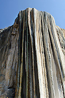 Looking up at the astonishing geological formations of Hierve el Agua.