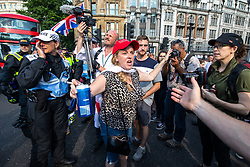 © Licensed to London News Pictures. 14/07/2018. London, UK. Supporters of EDL founder Tommy Robinson ( real name Stephen Yaxley-Lennon ) and US President Donald Trump block a bus at Trafalgar Square during a day of demonstrations and rallies in support and opposed to US President Donald Trump and jailed EDL founder Tommy Robinson . Trump is currently in Scotland and Robinson is in HMP Hull . Photo credit: Joel Goodman/LNP