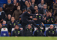 Football - 2016 / 2017 Premier League - Chelsea vs. Middlesborough<br /> <br /> Chelsea Manager Antonio Conte kicks the air in frustration after a near miss for Chelsea  at Stamford Bridge.<br /> <br /> COLORSPORT/DANIEL BEARHAM