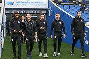 Leicester City players arrive on the pitch before the Premier League match between Brighton and Hove Albion and Leicester City at the American Express Community Stadium, Brighton and Hove, England on 24 November 2018.