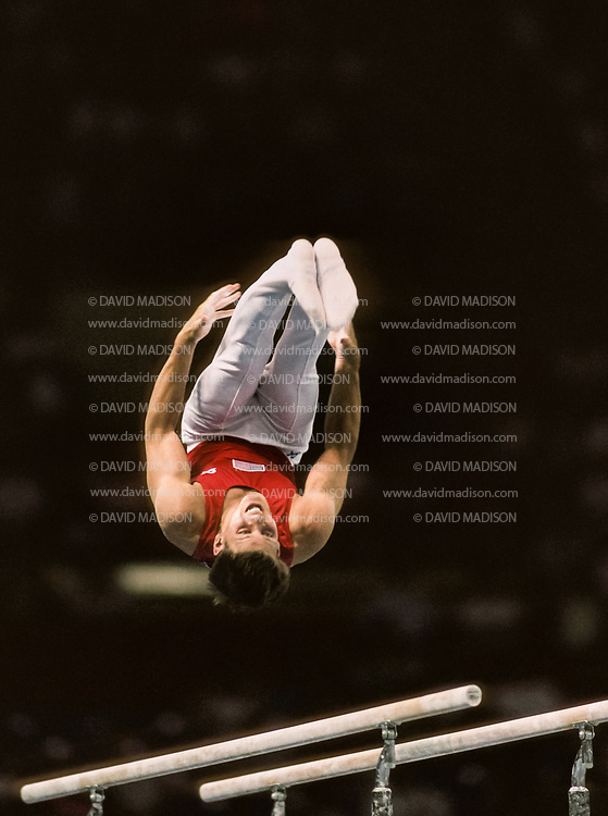 SEATTLE - JULY 1990:  Chris Waller of the United States performs on the parallel bars during the gymnastics competition of the 1990 Goodwill Games held from July 20 - August 5, 1990.  The gymnastics venue was the Tacoma Dome in Tacoma, Washington.  (Photo by David Madison/Getty Images)
