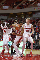 "08 February 2018:  William Tinsley grabs a rebound also sought after by Daouda ""David"" Ndiaye, Kavion Pippen and Taylor Bruninga during a College mens basketball game between the Southern Illinois Salukis and Illinois State Redbirds in Redbird Arena, Normal IL"