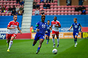 Wigan Jamal Lowe and Barnsley captain Mike Bahre during the EFL Sky Bet Championship match between Wigan Athletic and Barnsley at the DW Stadium, Wigan, England on 31 August 2019.