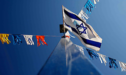 Sderot  - May 2nd ,  2008 - An Israeli flag flies  in the centre of Sderot, Southern Israel, The small town has frequent rocket attacks from Gaza, May 2nd, 2008. Picture by Andrew Parsons / i-Images