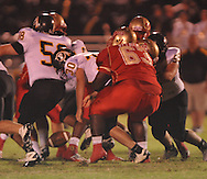 Lafayette High's D.Q. Reynolds (63) forces a fumble vs. Pontotoc in Oxford, Miss. on Friday, September 23, 2011. Lafayette won 48-7 for the school's 22nd consecutive win.