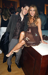 BRUCE WILPON and his wife  YUKI OSHIMA-WILPON at the Myla Debutantes Coming-Out show held at The Porchester Hall, Porchester Road, London on 31st January 2006.<br />