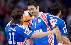 Ivan Cupic of Croatia and Blazenko Lackovic of Croatia celebrate after the handball match between Croatia and Spain for 3rd place game at 10th EHF European Handball Championship Serbia 2012, on January 29, 2012 in Beogradska Arena, Belgrade, Serbia.  Croatia defeated Spain 31-27 and won 3rd place. (Photo By Vid Ponikvar / Sportida.com)