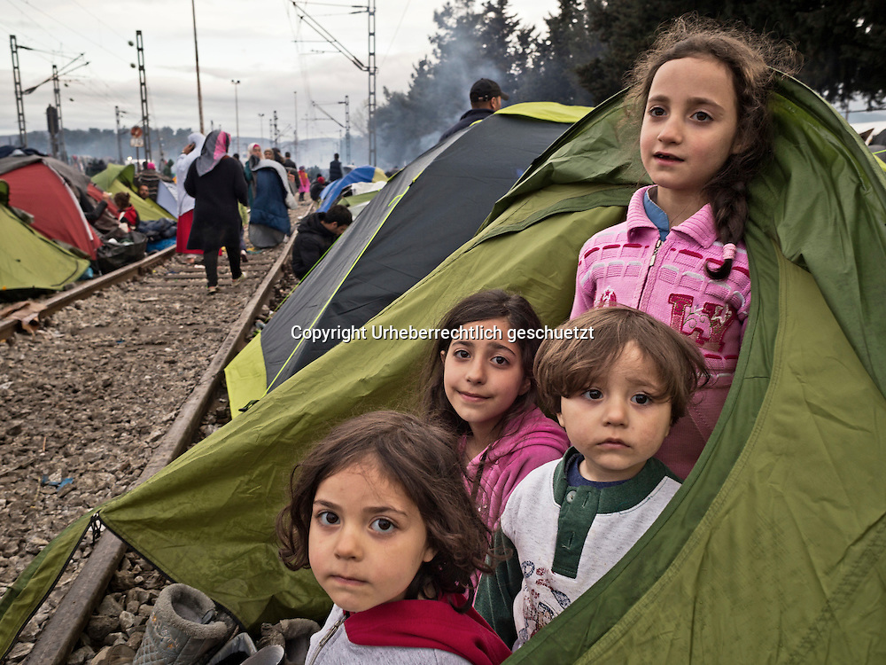 Greece, Idomeni, Refugees on their way to Europe - Eye of a Needle, Idomeni<br /> <br /> Families put there tents on the railroad tracks because of the heavy rain. Around the trainstation in Idomeni.<br /> <br /> Nadeloehr nach Nordeuropa Idomeni, der Grenzuebergang ist seit Tagen gesperrt,. <br /> Es ensteht im provisorischen Fluechtlingslager in Idomeni eine ngespannte Lage. <br /> Daueregen und Kaelte machen vor allem den Familien mit kleinen Kindern zu schaffen. <br /> <br /> Idomeni, is the eye of a needle for getting to nothern Europe. <br /> The FYRO macedonian authorities, closed the border from Greece completely. The situation close to the border gets more and more difficult. The People have to sleep outside or in small tents. <br /> Heavy rainfalls and cold nights are treating the refugees badly. Some already stayed up to ten nights at Idomeni. There is not enough food and supplies to help about 14.000 refugees.<br /> <br /> <br /> <br /> keine Veroeffentlichung unter 50 Euro*** Bitte auf moegliche weitere Vermerke achten***Maximale Online-Nutzungsdauer: 12 Monate !! <br /> <br /> for international use:<br /> Murat Tueremis<br /> C O M M E R Z  B A N K   A G , C o l o g n e ,  G e r m a n y<br /> IBAN: DE 04 370 800 40 033 99 679 00<br /> SWIFT-BIC: COBADEFFXXX
