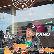 Busker playing guitar at Pike Place Market, Seattle.