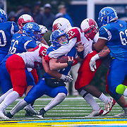 Middletown quarterback Drew Fry (8) is crunched by Smyrna's Diron Accoo (22) in the fourth quarter of the 2017  DIAA Division I state championship game between the Smyrna Eagles and Middletown Cavaliers Saturday, Dec. 02, 2017 at Delaware Stadium in Newark, DE.