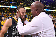 May 1, 2018; Oakland, CA, USA; Golden State Warriors guard Stephen Curry (30) talks to San Francisco Giants former outfielder Barry Bonds (right) after game two of the second round of the 2018 NBA Playoffs against the New Orleans Pelicans at Oracle Arena.