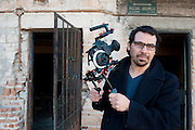 Documentary filmmaker Angel Estrada Soto in his childhood neighborhood in Ciudad Juarez, Mexico. ..LA FRONTERA: Artists along the US Mexican Border.© Stefan Falke.http://www.stefanfalke.com/