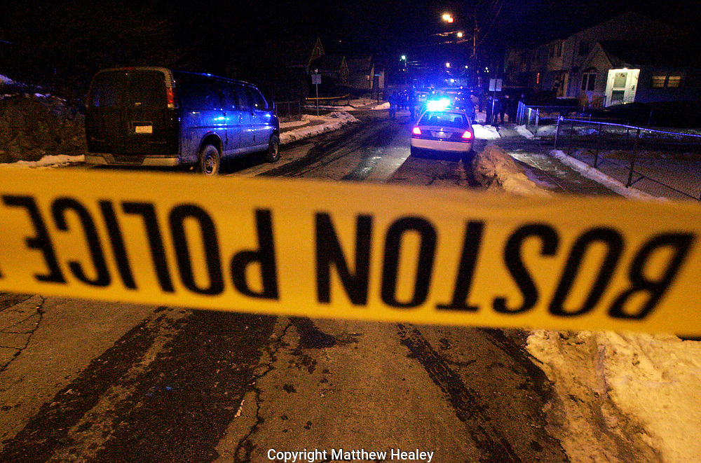 Boston police tape blocks off the scene of a triple shooting.  Photo by Matthew Healey
