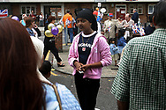 A young British Asian girl in Jubilee Street in Stepney Green, east London at a street party to celebrate Queen Elizabeth II's Golden Jubilee. Celebrations took place across the United Kingdom with the centrepiece a parade and fireworks at Buckingham Palace, the Queen's London residency. Queen Elizabeth ascended to the British throne in 1952 upon the death of her father, King George VI.